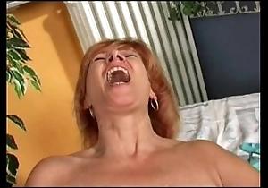 Redhead mature's mode herself